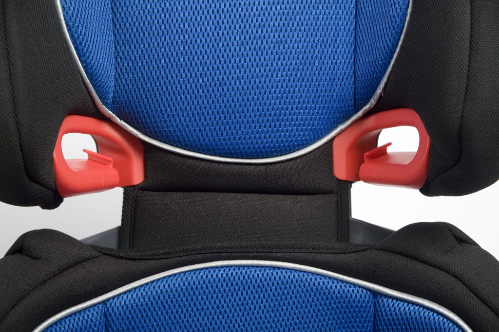 Close-up of a plastic slot guide on a booster seat