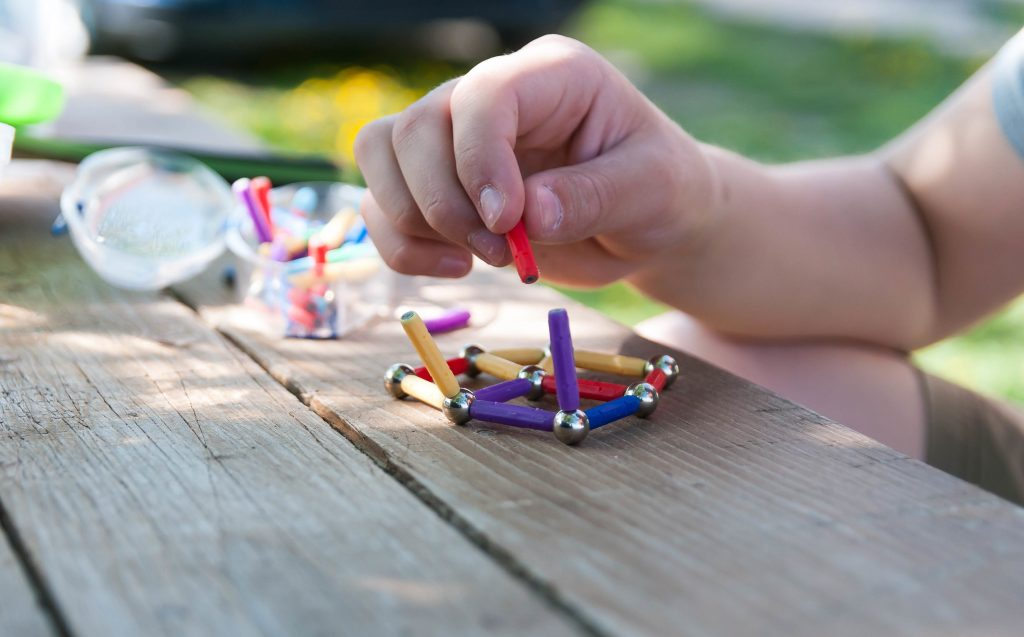 Close-up of someone playing with magnetic toys
